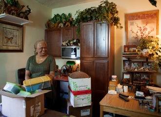Lantern resident Matoka Joyner packs up her belongings as she prepares to move to an independent apartment, through the Moving On program