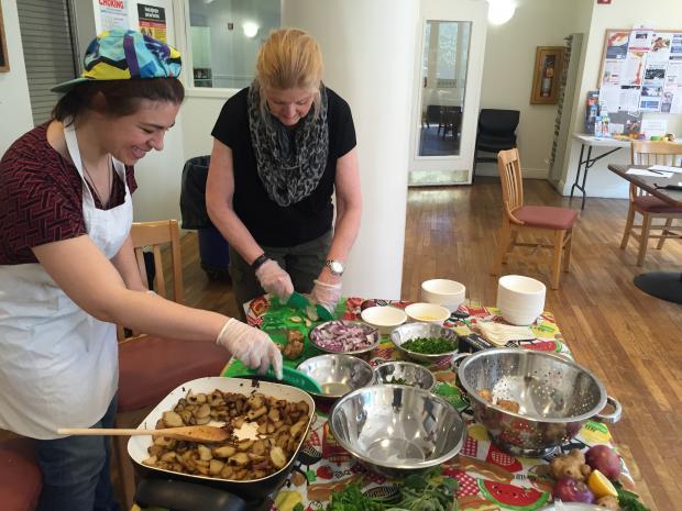 Health and Wellness Coordinator Stephanie and volunteer Gayle prepare a cooking demonstration for Lantern's Audubon Fresh Food Box program