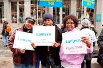Lantern residents pose with signs before the NAMI walk for mental illness
