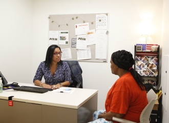 A Lantern Community Services social worker meets with a client in her office