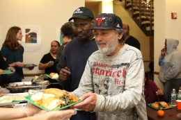 Lantern Community Services clients enjoy a Thanksgiving meal