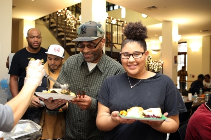A father and daughter enjoy a Thanksgiving meal at Lantern Community Services