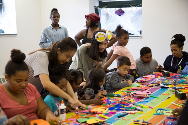 SVA students work with children who are Lantern residents, in a mask-making workshop