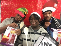 Participants in our young adult nutrition class, Food 4 Life, open their kitchen-themed gifts