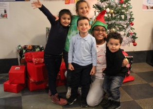 Children wait to receive their gifts in the Bronx