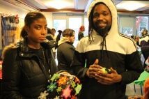 Young adult clients receive their gifts at a holiday event in the Bronx