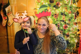 A mother and daughter celebrate at a holiday event in the Bronx