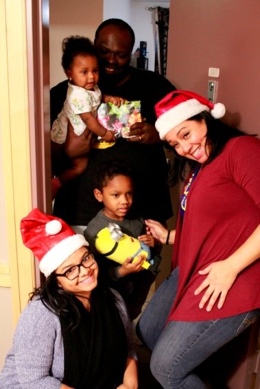 Lantern staff deliver gifts to a family in the Bronx