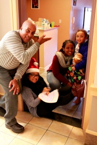 Lantern Community Services staff deliver gifts to families
