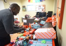 Lantern's Director of Employment, Whittaker Wright, prepares gifts in East Harlem