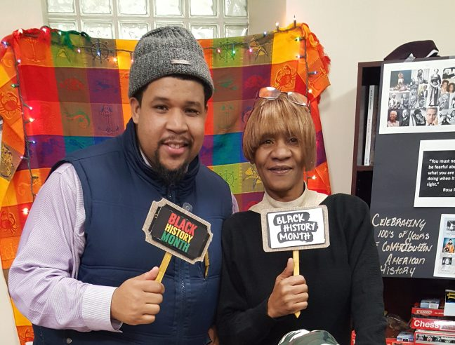 Rustin IPS Employment Specialist Aloke Blake and a resident at Black History Month open mic