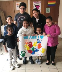 Lantern Case Manager Stephany Buffa and children with their Black History Month art work