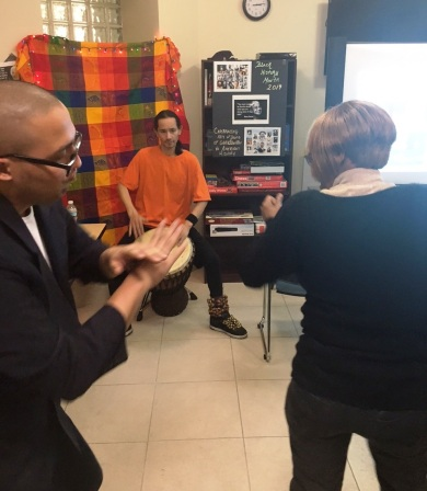 Staff and residents dance to drums as part of Rustin's Black History Month celebrations