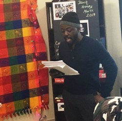 A performer in Rustin House's Black History Month Open Mic